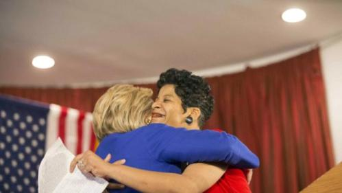 Democratic presidential candidate Hillary Clinton hugs Geneva Reed-Veal, mother of Sandra Bland, at a rally at Parkway Ballroom in Chicago, Illinois on February 17, 2016. REUTERS/Alex Wroblewski