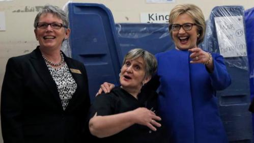 U.S. Democratic presidential candidate Hillary Clinton shares a laugh with workers in the linen room at Caesar's Palace during a campaign stop in Las Vegas, Nevada, United States, February 18, 2016. REUTERS/Jim Young