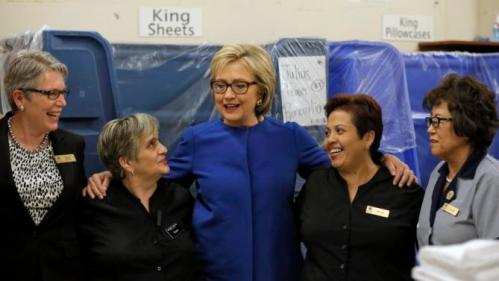 U.S. Democratic presidential candidate Hillary Clinton speaks to workers in the linen room at Caesar's Palace during a campaign stop in Las Vegas, Nevada, United States, February 18, 2016. REUTERS/Jim Young