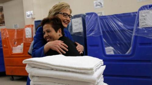 U.S. Democratic presidential candidate Hillary Clinton hugs linen room worker Miriam Deleon during a campaign stop at Caesar's Palace in Las Vegas, Nevada, United States, February 18, 2016. REUTERS/Jim Young