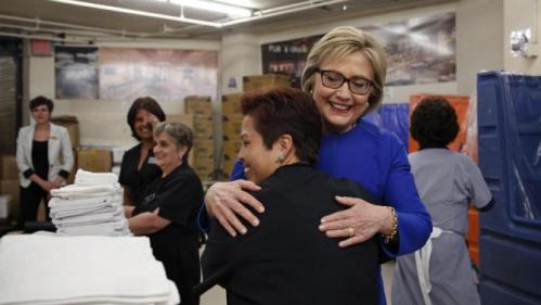 Democratic presidential candidate Hillary Clinton, in blue, hugs Caesars Palace employee Miriam Deleon during a visit to the hotel and casino Thursday, Feb. 18, 2016, in Las Vegas. (AP Photo/John Locher)