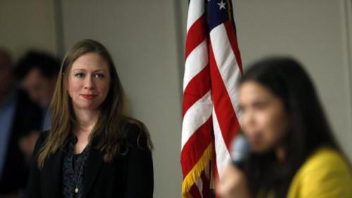 Chelsea Clinton, left, listens as actress America Ferrera introduces her during a campaign stop on behalf of Clinton's mother, Democratic presidential candidate Hillary Clinton, at The University of Denver, Thursday, Feb. 18, 2016, in Denver. (AP Photo/Brennan Linsley)