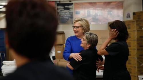 Democratic presidential candidate Hillary Clinton, in blue, hugs Caesars Palace employee Brana Narancic during a visit to the hotel and casino Thursday, Feb. 18, 2016, in Las Vegas. (AP Photo/John Locher)