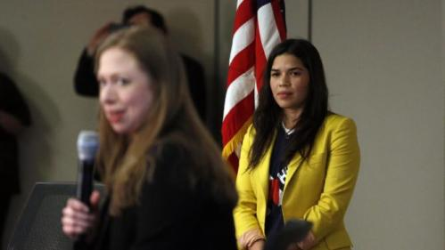 Actress America Ferrera, left, listens as Chelsea Clinton speaks to students during a campaign stop on behalf of Clinton's mother, Democratic presidential candidate Hillary Clinton, at The University of Denver, Thursday, Feb. 18, 2016, in Denver. (AP Photo/Brennan Linsley)