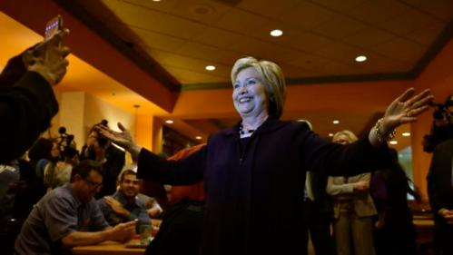 U.S. Democratic presidential candidate Hillary Clinton smiles for a photos as she greets workers in the employee dinning room at the Rio Hotel and Casino in Las Vegas, Nevada February 18, 2016. REUTERS/David Becker