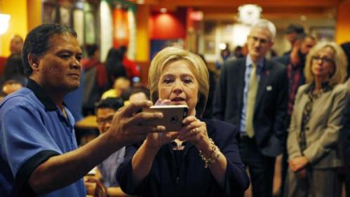 Democratic presidential candidate Hillary Clinton takes a selfie with an employee of the Rio during a visit to the hotel and casino Thursday, Feb. 18, 2016, in Las Vegas. (AP Photo/John Locher)