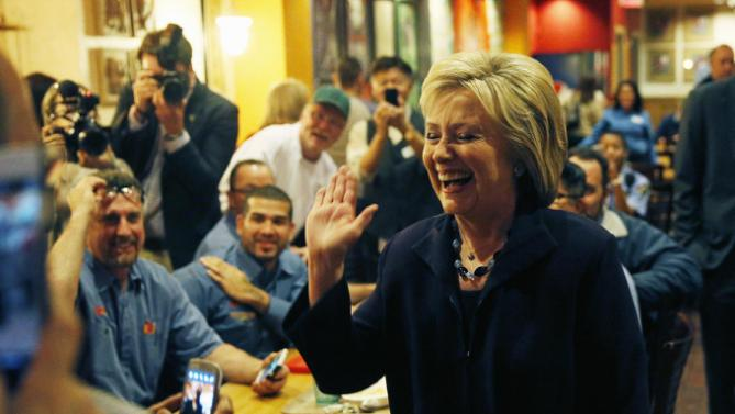 Democratic presidential candidate Hillary Clinton reacts while meeting with employees of the Rio during a visit to the hotel and casino, Thursday, Feb. 18, 2016, in Las Vegas. (AP Photo/John Locher)