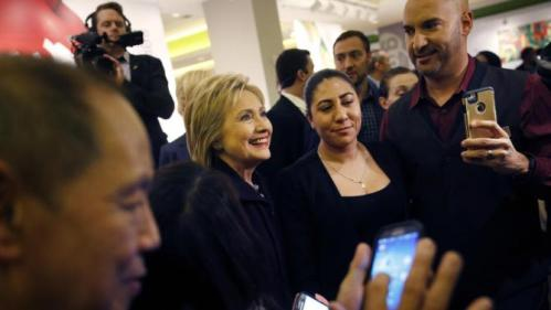 Democratic presidential candidate Hillary Clinton, second from left, meets with MGM Grand employees during a visit to the hotel and casino Thursday, Feb. 18, 2016, in Las Vegas. (AP Photo/John Locher)