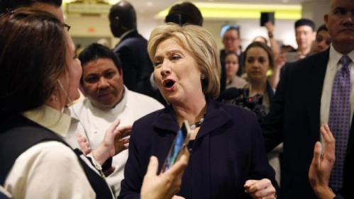 Democratic presidential candidate Hillary Clinton reacts while speaking with MGM Grand employees during a visit to the hotel and casino Thursday, Feb. 18, 2016, in Las Vegas. (AP Photo/John Locher)