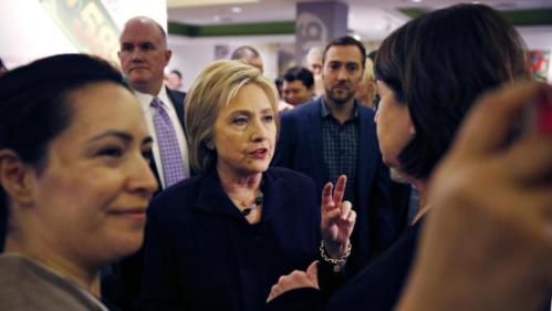 Democratic presidential candidate Hillary Clinton speaks with an MGM Grand employee during a visit to the hotel and casino Thursday, Feb. 18, 2016, in Las Vegas. (AP Photo/John Locher)