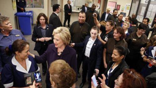 Democratic presidential candidate Hillary Clinton, second from left, meets with employees of Paris Las Vegas during a visit to the hotel and casino Thursday, Feb. 18, 2016, in Las Vegas. (AP Photo/John Locher)