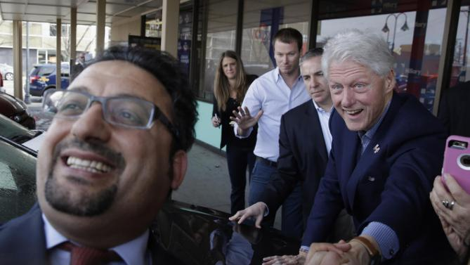 A supporter at left, takes a selfie with former President Bill Clinton, as Clinton campaigns for his wife, Democratic presidential candidate Hillary Clinton, Friday, Feb. 19, 2016, in Reno, Nev. (AP Photo/Marcio Jose Sanchez)