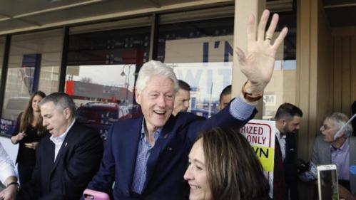 Former President Bill Clinton waves at supporters as he campaigns for his wife, Democratic presidential candidate Hillary Clinton, Friday, Feb. 19, 2016, in Reno, Nev. (AP Photo/Marcio Jose Sanchez)