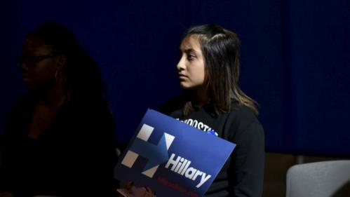 A supporter listens as U.S. Democratic presidential candidate Hillary Clinton speaks during a women and family roundtable at the College of Southern Nevada in North Las Vegas, Nevada February 19, 2016. REUTERS/David Becker