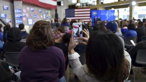 A supporter snaps a photo as U.S. Democratic presidential candidate Hillary Clinton speaks during a roundtable at the College of Southern Nevada in North Las Vegas, Nevada February 19, 2016. REUTERS/David Becker