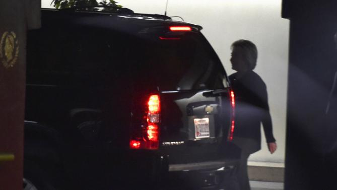 U.S. Democratic presidential candidate Hillary Clinton walks to her vehicle in the parking garage at Caesars Palace in Las Vegas, Nevada February 19, 2016. REUTERS/David Becker