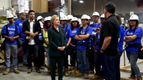 U.S. Democratic presidential candidate Hillary Clinton meets people while visiting YouthBuild, a non-profit organization which provides education, counseling and job skills to unemployed young adults in Las Vegas, Nevada February 19, 2016. REUTERS/David Becker