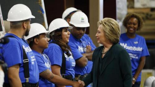 Democratic presidential candidate Hillary Clinton, second from right, meets with students at a Youthbuild program Friday, Feb. 19, 2016, in Las Vegas. Youthbuild helps low-income young people learn construction skills. (AP Photo/John Locher)