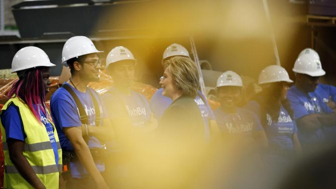 Democratic presidential candidate Hillary Clinton, center, meets with students at a Youthbuild program Friday, Feb. 19, 2016, in Las Vegas. Youthbuild helps low-income young people learn construction skills. (AP Photo/John Locher)