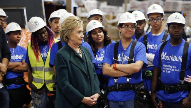 Democratic presidential candidate Hillary Clinton visits a Youthbuild program Friday, Feb. 19, 2016, in Las Vegas. Youthbuild helps low-income young people learn construction skills. (AP Photo/John Locher)
