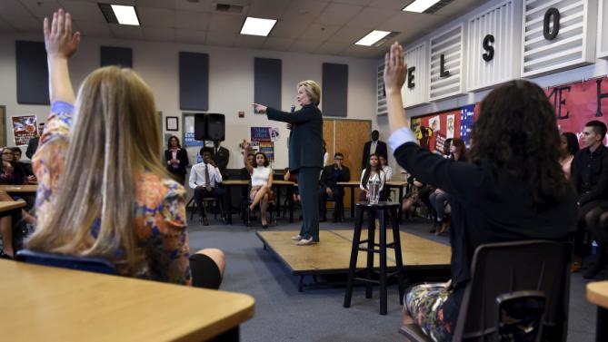 U.S. Democratic presidential candidate Hillary Clinton takes a question from a students at Del Sol High School in Las Vegas, Nevada February 19, 2016. REUTERS/David Becker