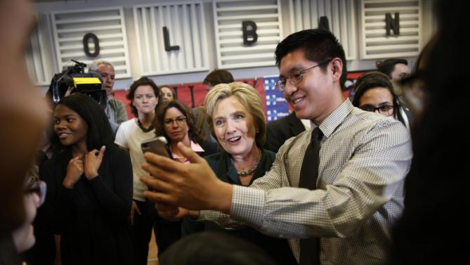 Democratic presidential candidate Hillary Clinton, center, poses for a selfie with a student at Del Sol High School, Friday, Feb. 19, 2016, in Las Vegas. (AP Photo/John Locher)