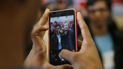 Democratic presidential candidate Hillary Clinton poses for a photo at Del Sol High School, Friday, Feb. 19, 2016, in Las Vegas. (AP Photo/John Locher)