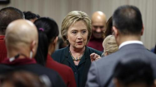 Democratic presidential candidate Hillary Clinton meets with employees of New York-New York Hotel & Casino during a visit to the hotel and casino school, Friday, Feb. 19, 2016, in Las Vegas. (AP Photo/John Locher)