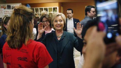 Democratic presidential candidate Hillary Clinton gestures while speaking to people at Planet Hollywood hotel and casino Friday, Feb. 19, 2016, in Las Vegas. (AP Photo/John Locher)