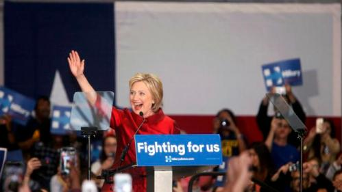 U.S. Democratic presidential candidate Hillary Clinton waves to supporters at a late night rally in Houston after winning the Iowa Democratic caucus, February 20, 2016. Picture taken late February 20, 2016. REUTERS/Daniel Kramer