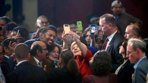 "U.S. Democratic presidential candidate Hillary Clinton takes a ""selfie"" with supporters at a late night rally in Houston after winning the Iowa Democratic caucus, February 20, 2016. Picture taken late February 20, 2016. REUTERS/Daniel Kramer"