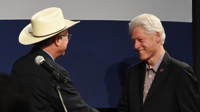 Former U.S. Secretary of the Interior and former U.S. Senator Ken Salazar greets former President Bill Clinton as Clinton prepares to give a speech  in support of his wife, Hillary Clinton, for president, on Sunday, Feb. 21, 2016.  (Jerilee Bennett/The Gazettevia AP)