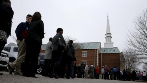 People wait in line to take part in a town hall meeting with U.S. Democratic presidential candidate Hillary Clinton at Central Baptist Church in Columbia, South Carolina February 23, 2016. REUTERS/Jonathan Ernst