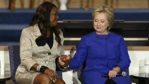 Sybrina Fulton (L), mother of shooting victim Trayvon Martin, endorses U.S. Democratic presidential candidate Hillary Clinton during a town hall meeting at Central Baptist Church in Columbia, South Carolina February 23, 2016. REUTERS/Jonathan Ernst TPX IMAGES OF THE DAY
