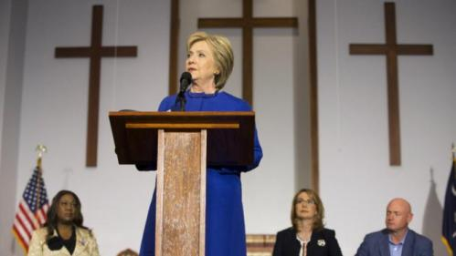 Democratic presidential candidate Hillary Clinton speaks during a rally at the Central Baptist Church in Columbia, S.C., on Tuesday, Feb. 23, 2016, with mothers of victims of gun violence including Sybrina Fulton, mother of Trayvon Martin, left, and former Rep. Gabrielle Giffords with her husband, retired astronaut Mark Kelly. (AP Photo/Jacquelyn Martin)
