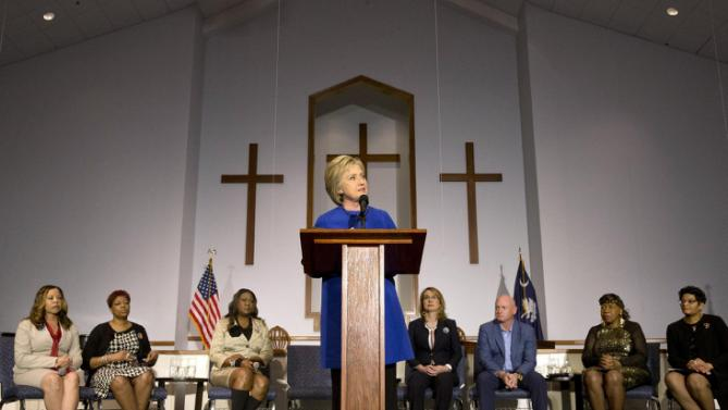 Democratic presidential candidate Hillary Clinton speaks during a rally at the Central Baptist Church in Columbia, S.C., on Tuesday, Feb. 23, 2016, with mothers of victims of gun violence from left Lucia McBath, mother of Jordan Davis, Maria Hamilton, mother of Dontre Hamilton, Sybrina Fulton, mother of Trayvon Martin, left, former Rep. Gabrielle Giffords with her husband, retired astronaut Mark Kelly, Gwen Carr, mother of Eric Garner, and Geneva Reed-Veal, mother of Sandra Bland. (AP Photo/Jacquelyn Martin)