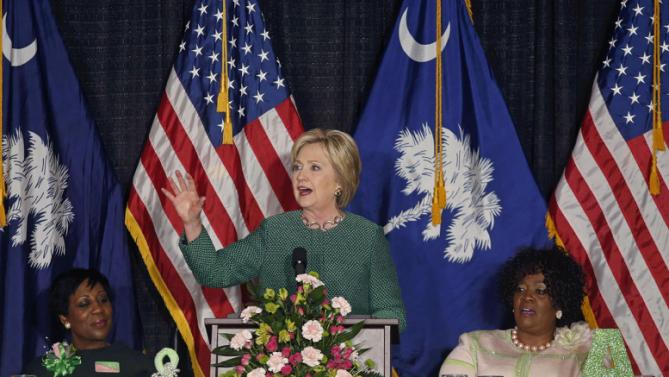 Democratic presidential candidate Hillary Clinton speaks at an Alpha Kappa Alpha Sorority luncheon in West Columbia, S.C., Wednesday, Feb. 24, 2016. Seated are AKA officers Kimberly Greene, left, and Sharon Brown Harriott. (AP Photo/Gerald Herbert)