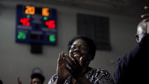 A supporter claps for U.S. Democratic presidential candidate Hillary Clinton at the Garrick-Boykin Human Development Center at Morris College in Sumter, South Carolina, February 24, 2016. REUTERS/Randall Hill
