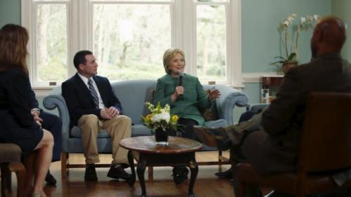 U.S. Democratic presidential candidate Hillary Clinton (center R) speaks with Jeff Ballard (center L), facilities director for the SC STRONG, and other residents on a tour of the home for ex-offenders and substance abusers on the grounds of the former Charleston Navy Yard in North Charleston, South Carolina February 24, 2016. REUTERS/Jonathan Ernst