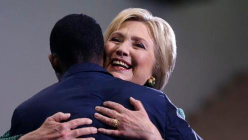 Democratic presidential candidate Hillary Clinton hugs Morris College junior class president Jake Sanders III, as he introduces her to speak at a campaign event at in Sumter, S.C., Wednesday, Feb. 24, 2016. (AP Photo/Gerald Herbert)