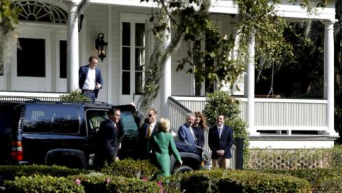 U.S. Democratic presidential candidate Hillary Clinton (C, back to camera in green coat) arrives for a tour of SC STRONG, a home for ex-offenders and substance abusers on the grounds of the former Charleston Navy Yard in North Charleston, South Carolina February 24, 2016. REUTERS/Jonathan Ernst