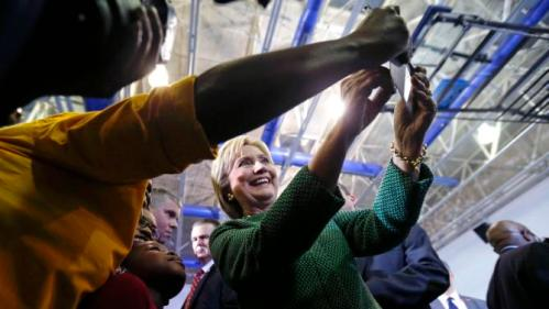 Democratic presidential candidate Hillary Clinton poses for photos with audience members after speaking at a campaign event at Morris College in Sumter, S.C., Wednesday, Feb. 24, 2016. (AP Photo/Gerald Herbert)
