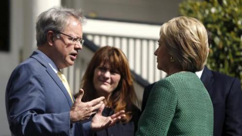 U.S. Democratic presidential candidate Hillary Clinton (R) speaks with Charleston Mayor John Tecklenburg (L) and his wife Sandy (2nd L) as she arrives for a tour of SC STRONG, a home for ex-offenders and substance abusers on the grounds of the former Charleston Navy Yard in North Charleston, South Carolina February 24, 2016. REUTERS/Jonathan Ernst
