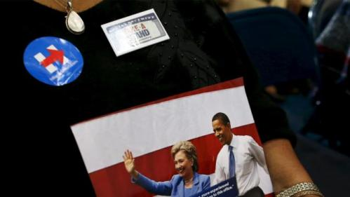 A supporter hold a photo of U.S. Democratic presidential candidate Hillary Clinton with U.S. President Barack Obama before a Clinton town hall meeting at the Garrick-Boykin Human Development Center at Morris College in Sumter, South Carolina, February 24, 2016. REUTERS/Randall Hill EDITORIAL USE ONLY. NO RESALES. NO ARCHIVE