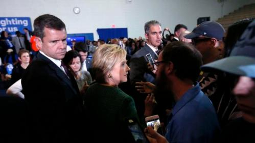Secret Service Agents Escort Democratic Presidential Candidate Hillary Clinton As She Greets Supporters After Speaking At