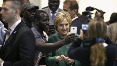 U.S. Democratic presidential candidate Hillary Clinton smiles as she records a Snapchat video for a supporter at the International Longshoremen's Association Local 1422 in Charleston, South Carolina February 24, 2016. REUTERS/Jonathan Ernst