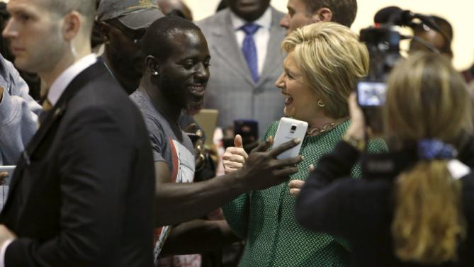 U.S. Democratic presidential candidate Hillary Clinton laughs after recording a Snapchat video for a supporter at the International Longshoremen's Association Local 1422 in Charleston, South Carolina February 24, 2016. REUTERS/Jonathan Ernst