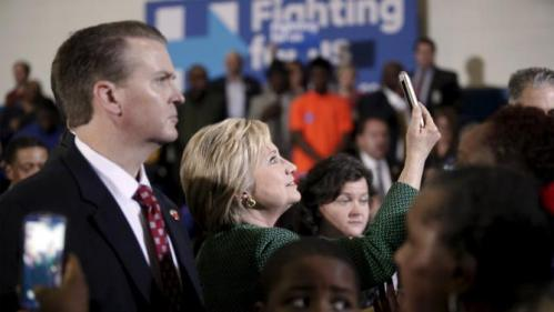 U.S. Democratic presidential candidate Hillary Clinton (C) takes a selfie for a supporter after her speech at the Garrick-Boykin Human Development Center at Morris College in Sumter, South Carolina, February 24, 2016. REUTERS/Randall Hill