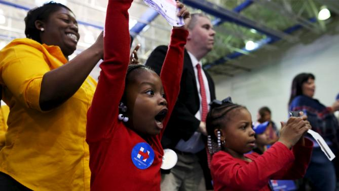 Six-year-old Kayla Johnson (C) her mother Andrea (L) and friend London Walters (R) react as U.S. Democratic presidential candidate Hillary Clinton enters the Garrick-Boykin Human Development Center at Morris College in Sumter, South Carolina, February 24, 2016. REUTERS/Randall Hill