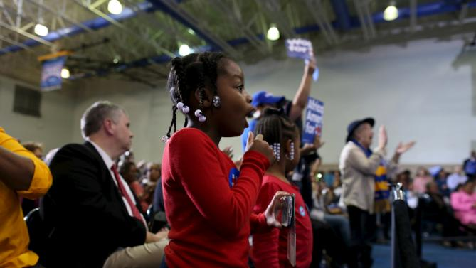 Six-year-old Kayla Johnson (C) of Sumter, South Carolina, reacts to the announcement of a speaker anticipating the arrival of U.S. Democratic presidential candidate Hillary Clinton at the Garrick-Boykin Human Development Center at Morris College in Sumter, South Carolina, February 24, 2016. REUTERS/Randall Hill
